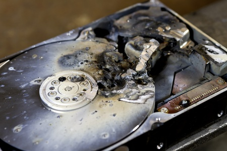 fixed disk: detail shot of a massive destroyed hard disk drive