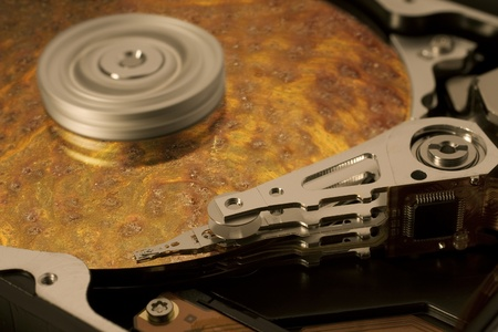 reachability: symbolic data rescue theme showing a opened hard disk with symbolic corroded surface Stock Photo