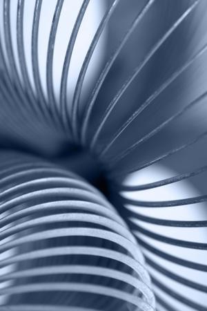 resortes: resumen de antecedentes industriales, que tienen un detalle azul, tonos de una espiral met�lica