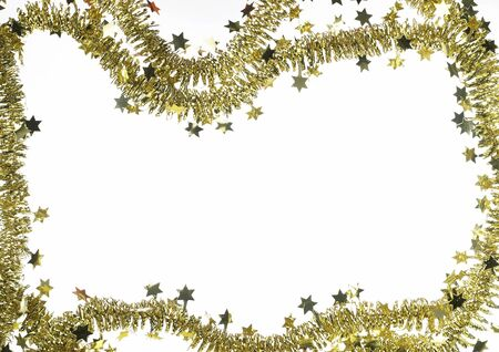 gewgaw: background with golden christmas garland and small stars isolated on white, with copyspace inside Stock Photo
