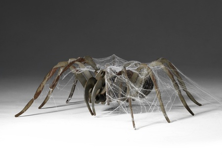 corroded metallic spider covered with artificial cobwebs Stock Photo - 10968794
