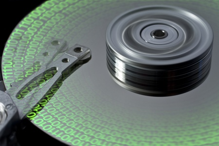 reachability: studio photography of a opened hard disk with symbolic data Stock Photo