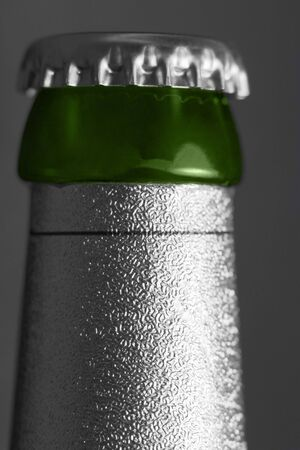 reflectance: detail of a green bottleneck with crown cap in grey back