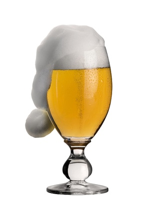 christmas drink: studio photography showing a glass of pils beer with funny foam shaped like a jelly bag cap in black back