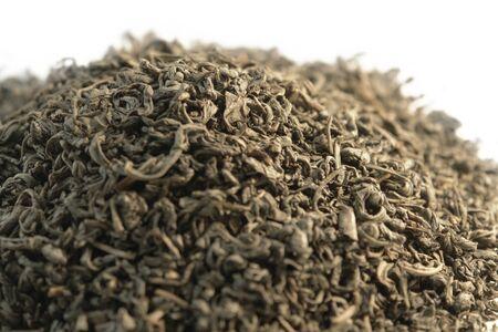 gunpowder tea: closeup of a pile with green chinese gunpowder tea