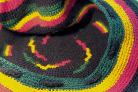 full frame background showing a colorful woolen knitted rasta cap photo