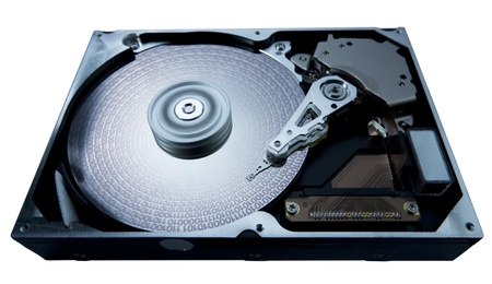 fixed disk: symbolic studio photography showing the detail of a opened hard disk, blue toned