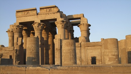 allegory painting: detail of a ancient temple in Kom Ombo (Egypt), sunny illuminated  at evening time