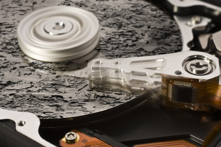 symbolic data loss theme showing a open hard disk with symbolic rotten data Stock Photo - 10914225