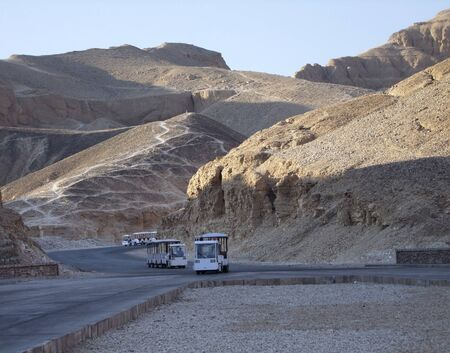 tourism scenery showing some busses on the way to the Valley of the Kings in Egypt