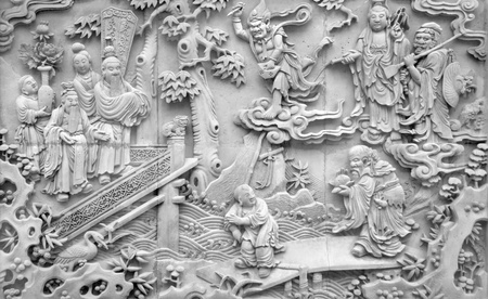 detail of a old historic stone relief seen at the Yuyuan Garden in Shanghai (China) photo