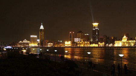 shanghai night: city view at night showing the Bund, an area of the Huangpu District in Shanghai which is a city in China Stock Photo