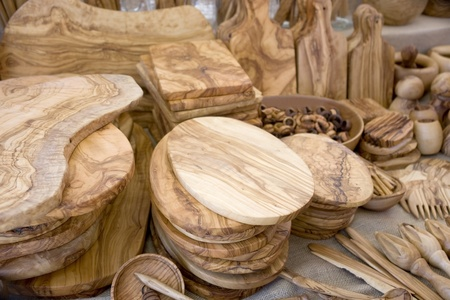 full frame background showing lots of decorative wooden tableware and kitchen equipment photo