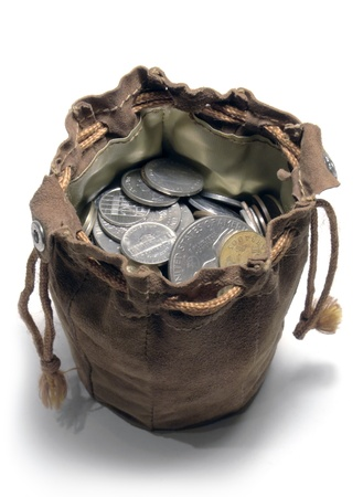 studio photography of a open leather moneybag filled with coins seen from above in white back photo