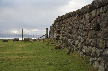 cloudy scenery in Scotlandwith stone wall Stock Photo - 10968449