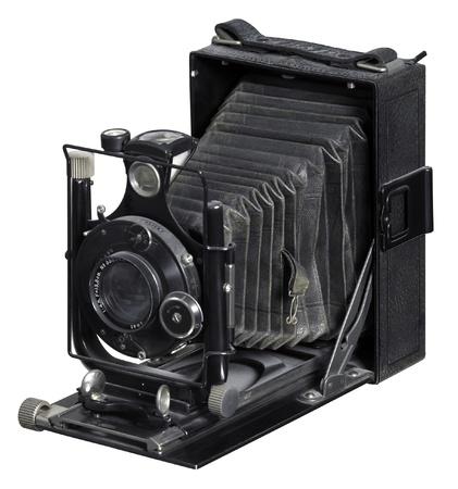 folding camera: nostalgic folding camera in white back Stock Photo