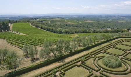 winegrowing: idyllic scenery with ornamental garden around Castle of Brolio near Gaiole in Chianti, located in the italian region Tuscany Editorial
