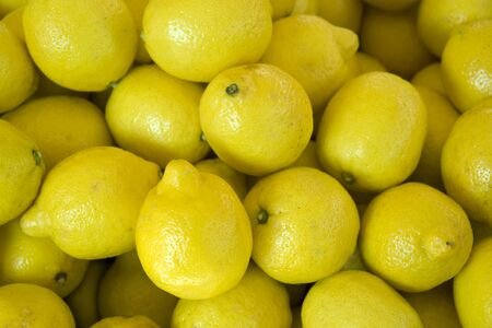 full frame background with lots of fresh yellow citrons Reklamní fotografie