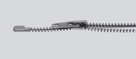 reachability: low angle view of of a zipper in light back