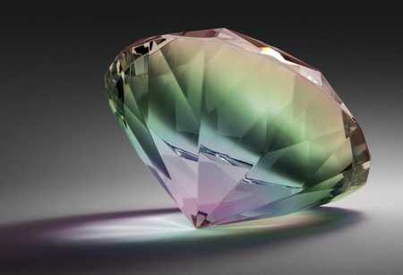 balance rainbow colors: studio photography of a glass diamond in rainbow colors in dark gradient back with clipping path