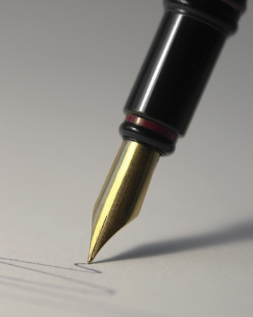 fountain pen: detail of a fountain pen while drawing a line in grey back