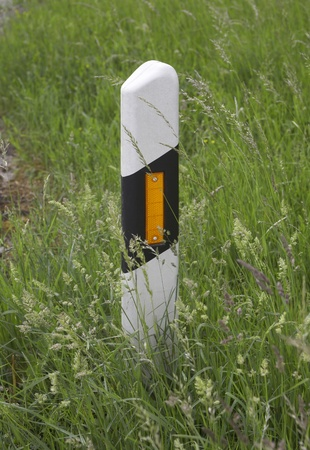 reflector post near road in green grass Stock Photo - 11960068
