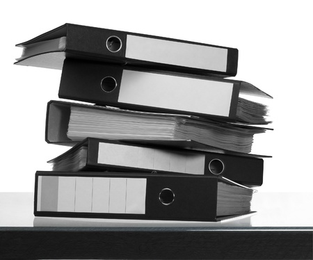 some Folders on desk surface in white back Stock Photo - 10917107