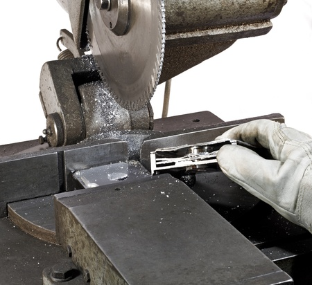 buzz saw: detail of a circular saw and halved hard disk in white back Stock Photo