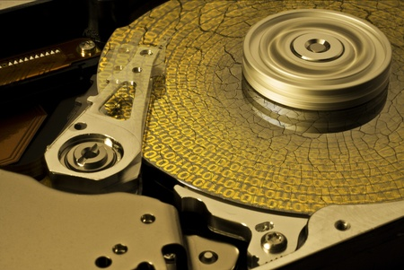 fixed disk: symbolic data rescue theme showing a opened hard disk with symbolic corroded surface Stock Photo