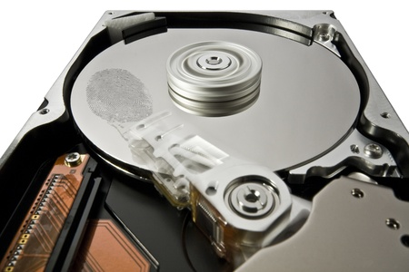 symbolic security theme showing a opened hard disk at work with big fingerprint Stock Photo - 10917219