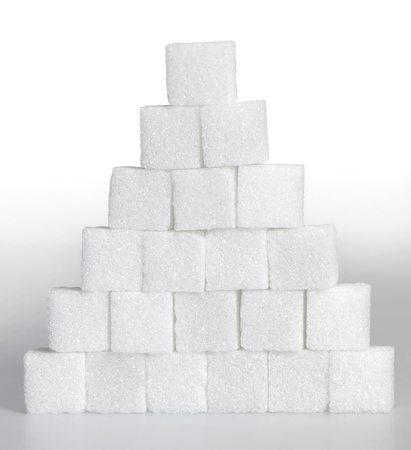 usual: Studio photography of a pyramid made of lump sugar pieces in light gradient back Stock Photo