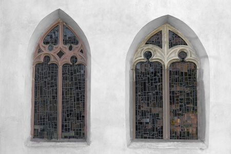 outdoor shot showing two old church windows photo