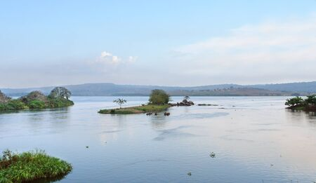 idyllic waterside scenery around River Nile source in Uganda (Africa) at evening time