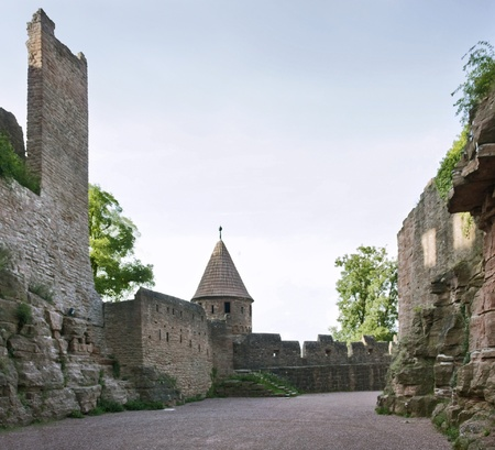 wertheim: detail of the Wertheim Castle in Southern Germany with small tower, walls and patio at evening time Editorial