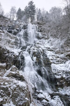 waterfall near Todtnau, a town in the Black Forest in Germany at winter time photo
