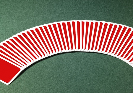 studio photography of spread out playing cards in a row with one chosen, located on green felt background Stock Photo - 10967908