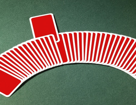 studio photography of spread out playing cards in a row with one chosen, located on green felt background Stock Photo - 10967933