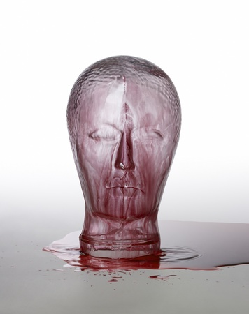 emotionless: generic human dummy head made of glass, overwhelmed with red fluid in light grey back