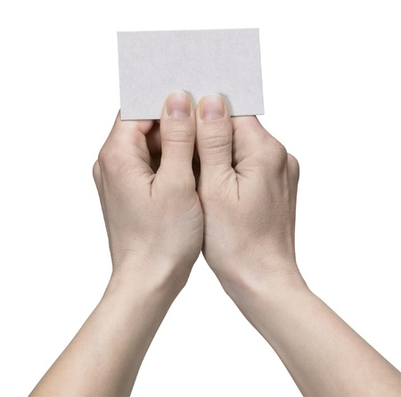 studio photography of hands holding a unwritten card in white back Stock Photo - 10917024