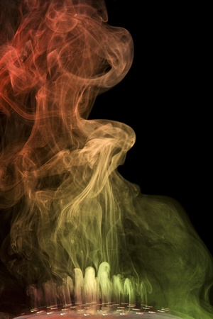 wavily: abstract picture showing some colorful smoke floating through lots of holes
