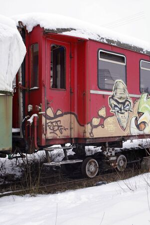 outdoor shot of a old tagged railway car in Southern Germany at winter time