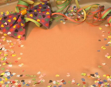 fluting: colorful symbolic carnival and party background with decorative blow-out, bow tie and confetti Stock Photo