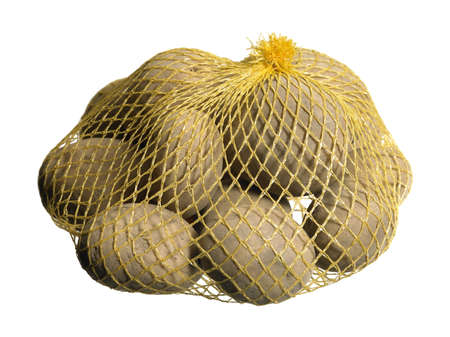 potatoes in a net in white back photo