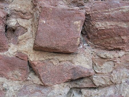 wertheim: reddish stone wall detail of Wertheim Castle in Southern Germany