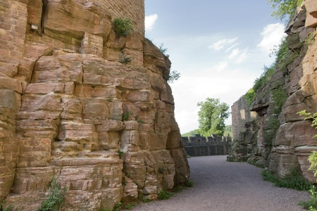 wertheim: scenery around Wertheim Castle in Southern Germany showing a passage surrounded by rock formations and walls at summer time Stock Photo