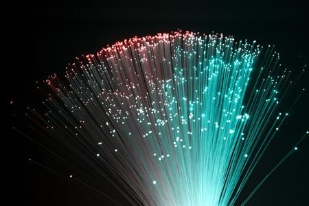fiber optic lamp: colorful illuminated plastic optical fibers in dark back
