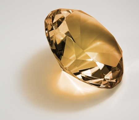 allegory painting: studio photography of a gold toned diamond in light back  Stock Photo