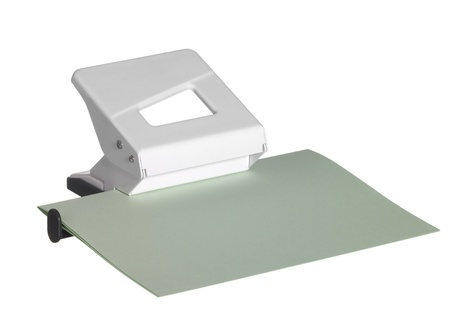 paper puncher: studio photography of a white hole puncher and paper sheet isolated on white