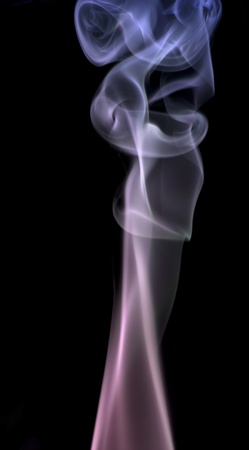 wavily: abstract picture showing some multicolored smoke in black background Stock Photo