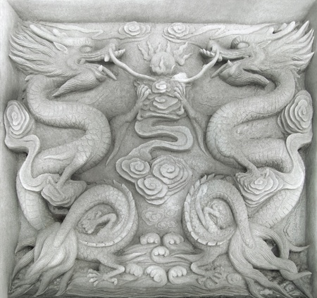 allegory painting: stone relief in a historic district named Fengdu County a necropolis in China built over 1800 years ago. The relief is showing two fire-drakes